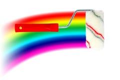 Rodillo y arco iris de pintura Foto de archivo