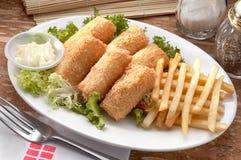 Rodillo y fritadas fritos de los pescados Imagen de archivo