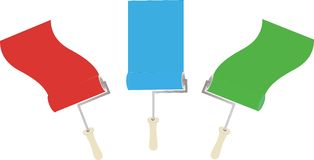 Rodillos de pintura que aplican la pintura Foto de archivo libre de regalías