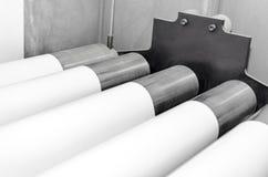 Rodillos y papel de la impresión del rollo Fotografía de archivo