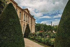 Rodin Museum building, gardens and Eiffel Tower in Paris. royalty free stock image