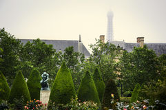 Rodin Museum, Paris. France - The Thinker,most famous sculpture by Rodin in the rose garden with  the Eiffel tower on the background Stock Image