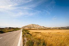 Rodos. Long road in prairie on Rhodes island Royalty Free Stock Images