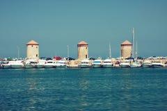 Rodos windmills. Of Mandraki harbor. Toned photo Royalty Free Stock Photos
