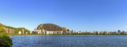 Rodrigo de Freitas Lagoon and hills panorama. Panoramic image of famous landscape of Rio de Janeiro with the Rodrigo de Freitas Lagoon and hills Stock Images