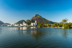 Rodrigo de Freitas Lagoon. View or Mountains and Buildings of Rio de Janeiro around Rodrigo de Freitas Lagoon Stock Photos