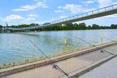 Rods at lake bank Stock Photo