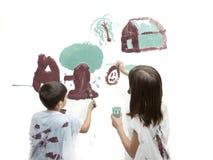 Rodzeństwa maluje obrazek Obraz Stock