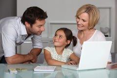 Rodzice i młoda córka Zdjęcie Stock