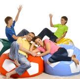 Rodzina składająca się z czterech osób bawić się Obrazy Royalty Free
