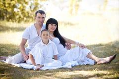 Rodzina z słońcem na naturze Obrazy Stock