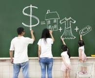 Rodzinni rysunkowi pieniądze domu ubrania i wideo gra