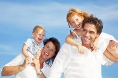 rodzinni szczęśliwi potomstwa obrazy stock