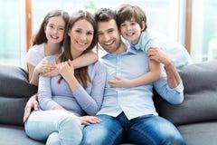 Rodzinny obsiadanie na leżance Obraz Royalty Free