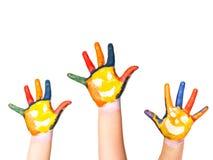 Rodzinny pojęcie. Trzy kolorowej ręki z uśmiechniętą twarzą rodzina matka, ojciec i dziecko -. Mały, środku i wielki ręko. Symbol  fotografia stock