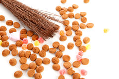 Roe of black Pete ( zwarte Piet). And pepernoten ( ginger nuts) over white background stock photography