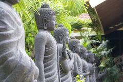Row of Buddha statue in Mojokerto, Indonesia. Roe of Buddha statue carved from natural stone in Mojokerto, Indonesia royalty free stock photo