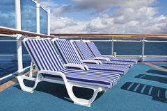 Roe of deck chairs on sundeck of the cruise ship Royalty Free Stock Images