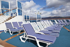 Roe of deck chairs on sundeck of the cruise ship Royalty Free Stock Photo