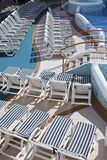 Roe of deck chairs on sundeck of the cruise ship Stock Photography