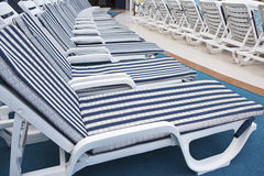 Roe of deck chairs on sundeck of the cruise ship Royalty Free Stock Image