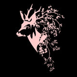 Roe deer among blooming branches Stock Images