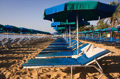 Roe of striped deck chairs on the beach Royalty Free Stock Images