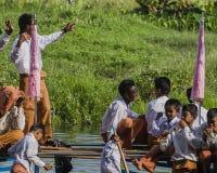 Roeiers op de boot Stock Afbeeldingen