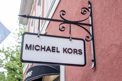 Roermond Netherlands 07.05.2017 Logo of the MK - Michael Kors Store in the Mc Arthur Glen Designer Outlet shopping area Royalty Free Stock Photo