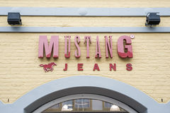 Roermond Netherlands 07.05.2017 Logo of the Mustang jeans Store in the Mc Arthur Glen Designer Outlet shopping area Stock Image