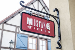 Roermond Netherlands 07.05.2017 Logo of the Mustang jeans Store in the Mc Arthur Glen Designer Outlet shopping area Stock Photo