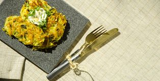 Roesti. Potatoes grated with greens fried in butter. Vegetarian table royalty free stock photography