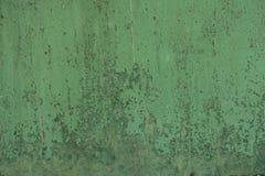 Roestig groen geschilderd metaal stock foto's