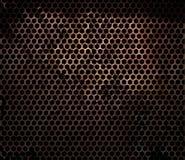 Roestig hexagonaal metaaltraliewerk Stock Foto