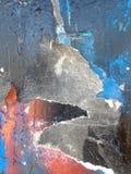 Roestig oppervlakte ijzig blauw met de wenk van rood op zwarte royalty-vrije stock afbeeldingen