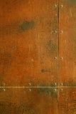 Roestig staal met klinknagels Stock Foto