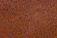 Roestige geel-rode geweven metaaloppervlakte De textuur van het metaalblad is naar voren gebogen aan oxydatie en corrosie grunge Royalty-vrije Stock Foto