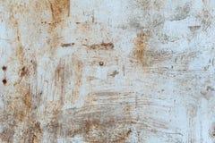 Roestige metaaltextuur met krassen en barsten verfsporen Blauwe en vuile oranje kleuren De ruimte van het exemplaar royalty-vrije stock fotografie