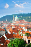 Rofs of old Prague with church of St. Nicolas in spring Stock Photography