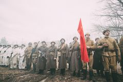 Re-enactors Dressed As Russian Soviet Infantry Soldiers Of World War II Standing In Row. Rogachev, Belarus - February 25, 2017: Re-enactors Dressed As Russian Stock Photos
