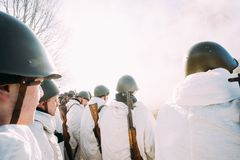 Re-enactors Dressed As Russian Soviet Infantry Soldiers Of World War II Standing In Row. Rogachev, Belarus - February 25, 2017: Re-enactors Dressed As Russian Royalty Free Stock Photo