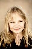 Rogación de la niña Imagen de archivo