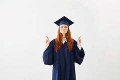 Rogación graduada de la hembra hermosa del pelirrojo sobre el fondo blanco Copie el espacio Fotos de archivo libres de regalías