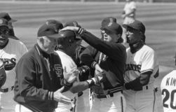 Roger Craig. San Francisco Giants manager Roger Craig celebrates an extra inning victory with his team. Image taken from b&w negative stock photography