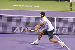 Roger Federer in action. During the January 2011 ATP Mens Open in Doha, Qatar Stock Photography