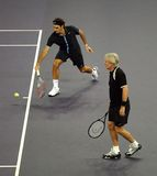 Roger Federer and Bjorn Borg in actions. Tennis players Roger Federer of Switzerland and Bjorn Borg of Sweden actions during an exhibition tennis match against Stock Image