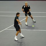 Roger Federer and Bjorn Borg in actions. Tennis players Roger Federer of Switzerland and Bjorn Borg of Sweden actions during an exhibition tennis match against Stock Photo