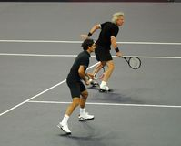 Roger Federer and Bjorn Borg in actions. Tennis players Roger Federer of Switzerland and Bjorn Borg of Sweden actions during an exhibition tennis match against Stock Photos