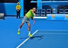 Roger Federer serving. MELBOURNE, AUSTRALIA - JANUARY 21: Roger Federer of Switzerland serves in his second round match against Simone Bolelli of Italy during Stock Image