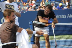 Roger Federer and Stanislas Wawrinka. Swiss tennis players Roger Federer and Stanislas Wawrinka practicing together at the 2013 US open tennis tournament Royalty Free Stock Image